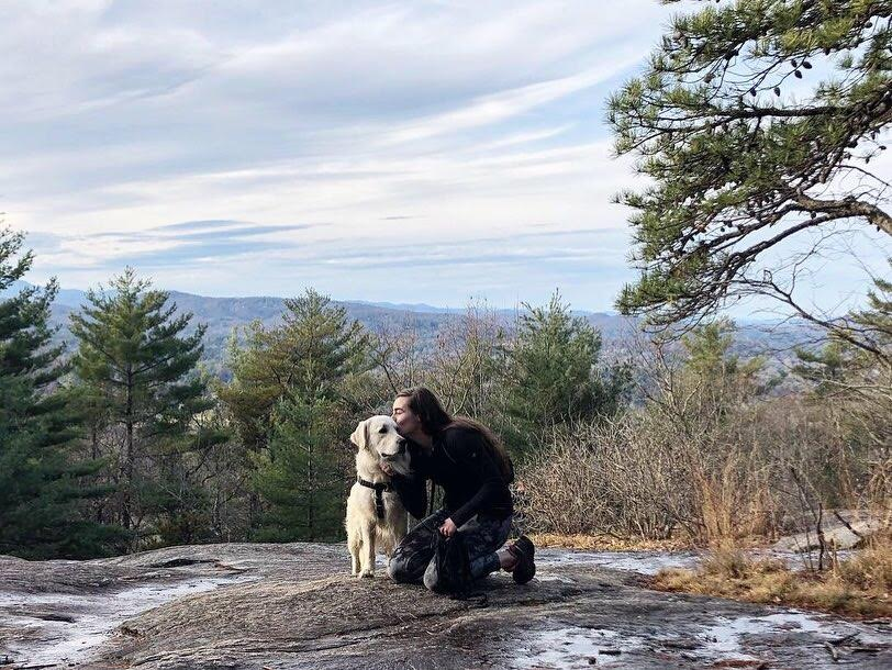 Girl and white golden retriever at the top of Big Glassy Mountain
