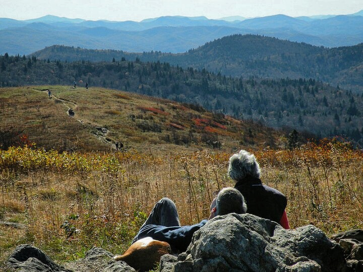 Two people looking at the mountains from Black Balsam Knob